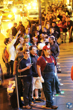 A Nintendo fan dressed as video game icon Mario leads a crowd of hundreds in line to be the first to buy the lighter, brighter Nintendo DS Lite hand-held video game system at the Nintendo World store.