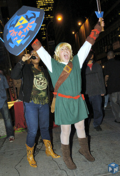 A Nintendo fan dressed as Link from the Legend of Zelda series rallies a crowd of hundreds in line to be the first to buy the lighter, brighter Nintendo DS Lite.