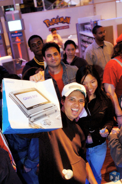 Luciano Caspaneda of Staten Island, N.Y., becomes one of the first people to buy the new Nintendo DS Lite.